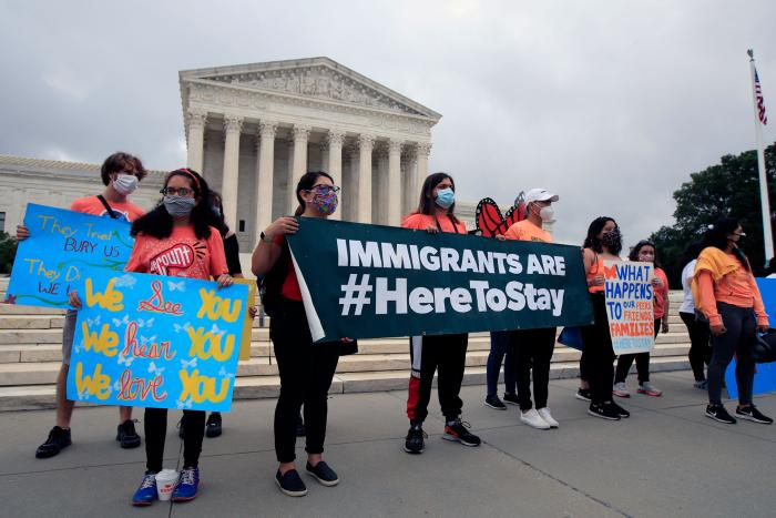 Deferred Action for Childhood Arrivals (DACA) students celebrate in front of the Supreme Court in Washington, DC, June 18, 2020.