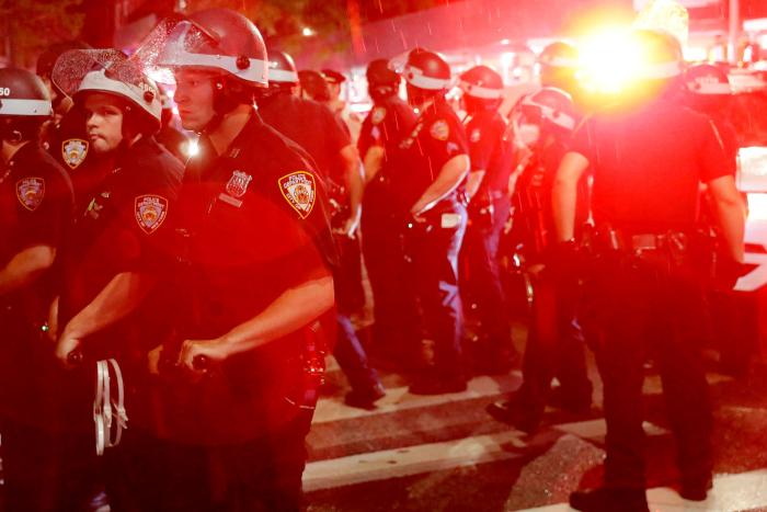 Police stand by as other officers arrest protesters in New York, Wednesday, June 3, 2020.