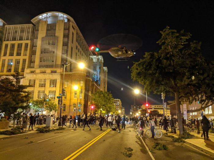 "A US military UH-72A ""Lakota"" hovers low over protesters on June 1, 2020 in Washington, DC, battering them with its rotor wash and sending debris flying."