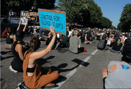 Demonstrators gather at the Minnesota governor's mansion Monday, June 1, 2020, in St. Paul, Minn. Protests continued following the death of George Floyd, who died after being restrained by Minneapolis police officers on Memorial Day.