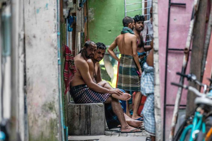 Foreign workers from Bangladesh gather in an alleyway of an accommodation block after being put under quarantine to contain the spread of Covid-19, May 9, 2020 in Male, Maldives.