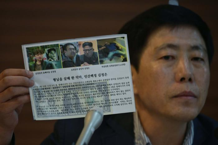 Activist Park Sang-hak holds a leaflet depicting the death of Kim Jong Nam, half-brother to North Korean leader Kim Jong Un, during a press conference in Seoul on July 6, 2020. © 2020 Photo by ED JONES/AFP via Getty Images