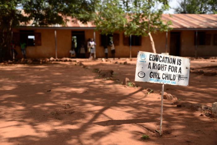 "This file photo shows a sign reading ""Education is a right for a girl child"" at a refugee settlement of people from South Sudan in Imvepi, Uganda, 27 June 2017."