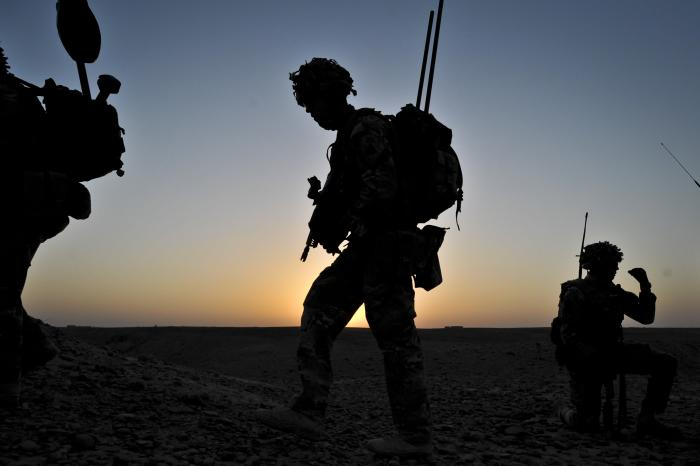 British troops conduct a dawn foot patrol in Helmand Province, Afghanistan, May 10, 2013.