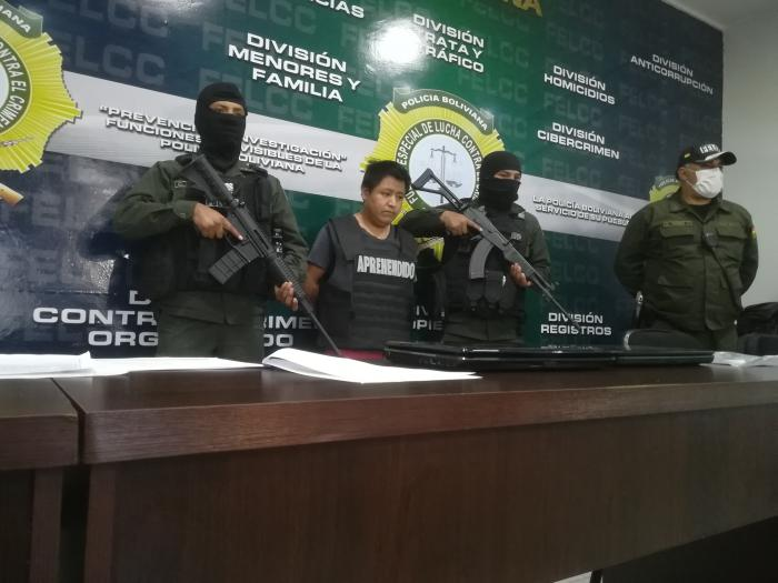 Police present Mauricio Jara, who is facing criminal charges for sharing WhatsApp messages criticizing the interim government and in support of former president Evo Morales, at a press conference on April 22, 2020.