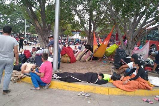 Venezuelans returning to their country wait in an overcrowded quarantine center (called PASI) set up by Venezuelan authorities at a San Antonio del Táchira bus terminal, April 2020.