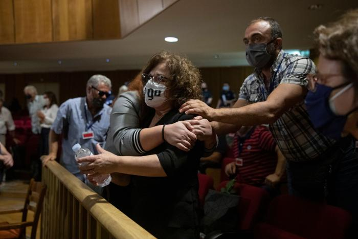 Magda Fyssa, the mother of late Greek rap singer Pavlos Fyssas, who was stabbed and killed by a supporter of the extreme right Golden Dawn party in 2013, celebrates immediately after the delivery of the verdict in Athens, October 7, 2020.