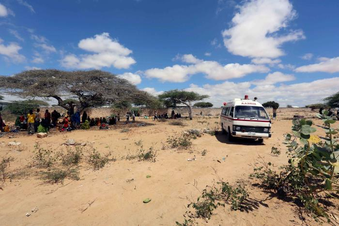 An ambulance transports patients to a  hospital from a camp for the internally displaced people on the outskirts Mogadishu, Somalia, March 2017.