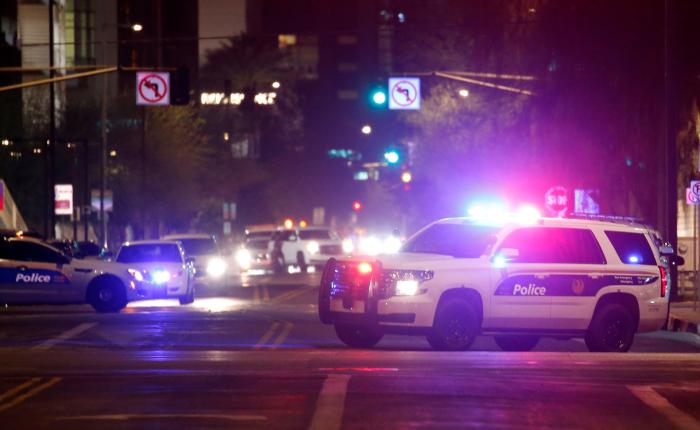 Phoenix Police Department vehicles block off a street in Phoenix, Arizona, May 30, 2020.
