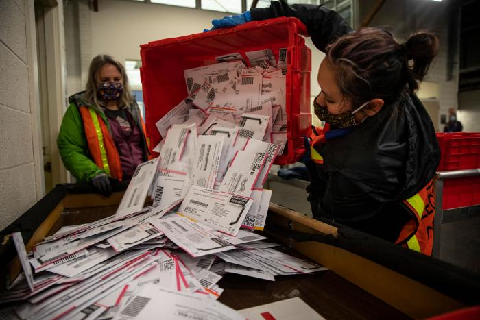 Election workers empty ballots at the Multnomah County Elections Division in Portland, Oregon, November 3, 2020.