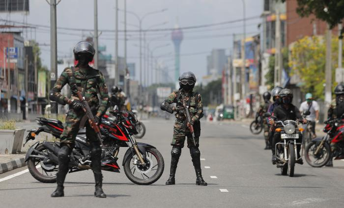 Armed soldiers guard a street