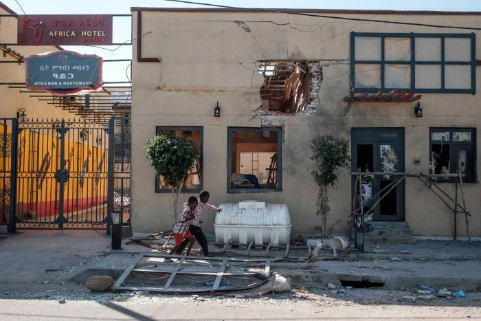 Children in front of the Africa/Ayga hotel likely damaged by a direct fire weapon in Humera town, Tigray region, Ethiopia, on November 22, 2020.