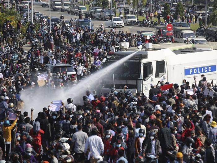 Police use a water cannon on a crowd of protesters in Naypyitaw, Myanmar on Monday, February 8, 2021.