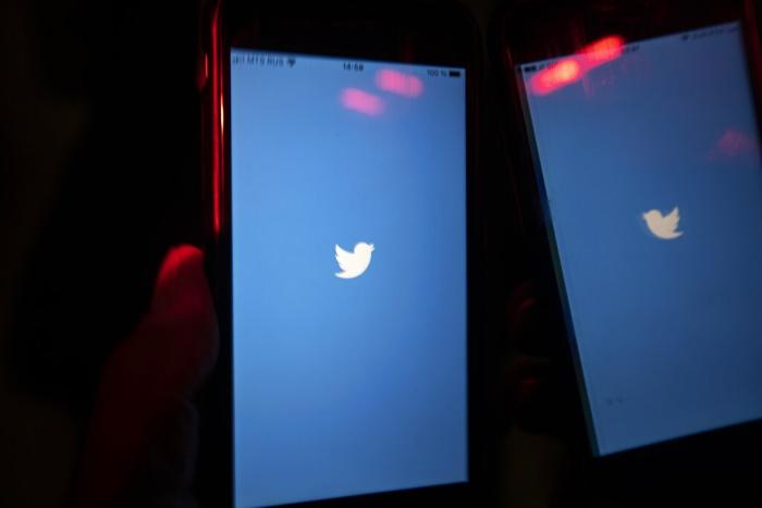 A mobile phone user turns on Twitter application on his smartphone in Moscow, Russia, Wednesday, March 10, 2021.