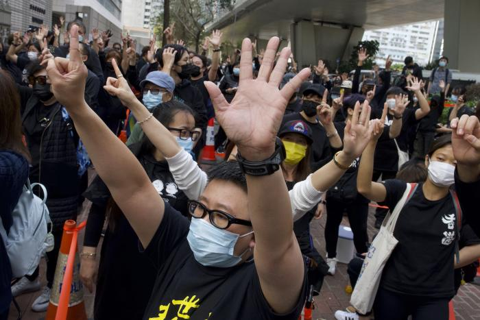 Supporters protest outside a court in Hong Kong where police brought 47 pro-democracy activists, March 1, 2021.
