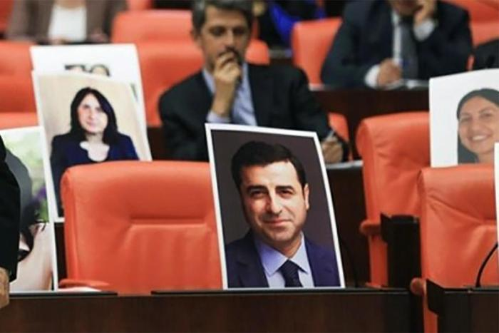 Selahattin Demirtaş, former co-chair of the Peoples' Democratic Party (HDP), was among MPs jailed on November 4, 2016. His vacant seat in the general assembly of Turkey's parliament is shown here marked with his photo.