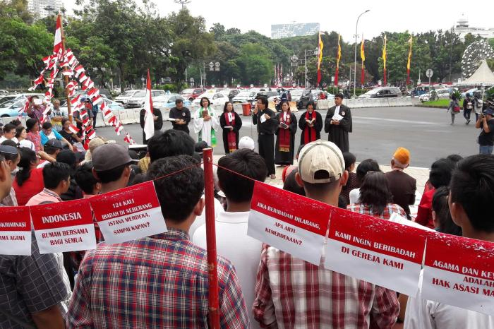 Indonesia's religious minorities, including Christians, Ahmadis, Buddhists and native faith believers, celebrateIndonesia's Independence Day outside the State Palace in Jakarta