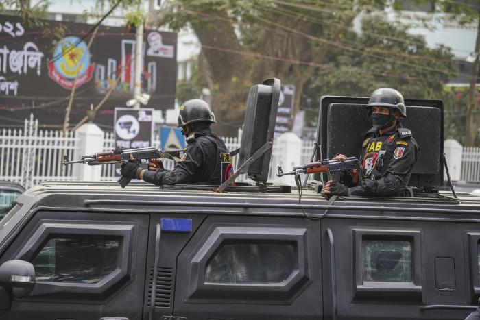 Rapid Action Battalion (RAB) officialsstandalert inside a truck in front of Central Shaheed Minar in Dhaka, Bangladeshon February 20, 2021.