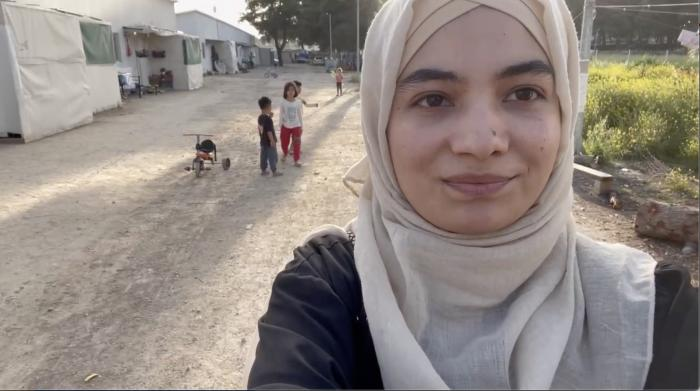 A refugee girl living in a camp near Athens.