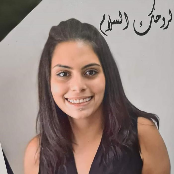 A picture of Suha Jarrar and flowers prepared by the staff of the Palestinian human rights group al-Haq and displayed at a commemoration for Jarrar in Ramallah in the Israeli-occupied West Bank on July 12, 2021