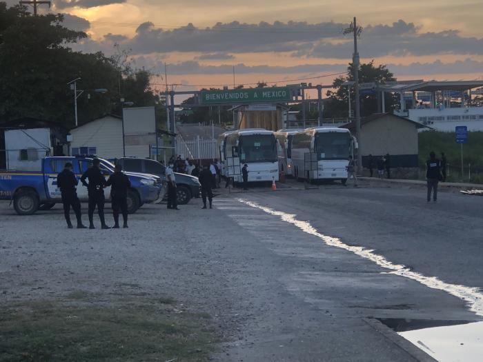Buses sit on the Mexican side of the El Ceibo border crossing after having expelled migrants into Guatemala.