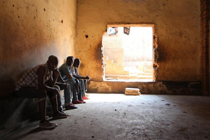 Rwandans sit in the Gikondo transit center in Kigali on September 24, 2015.