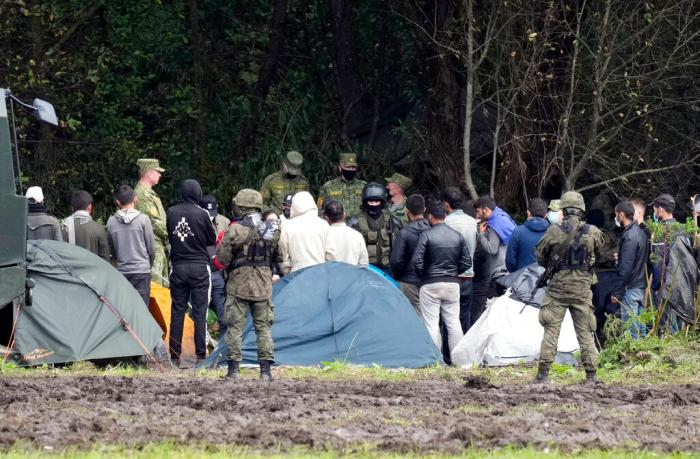 Polish security forces surround migrants at the border with Belarus in Usnarz Gorny, Poland on September 1, 2021.