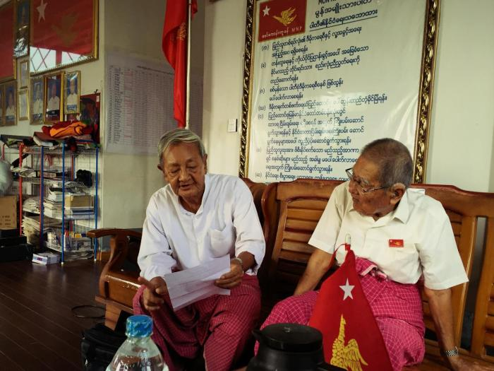 Naing Ngwe Theim and Naing Ngwe Thein, the chair and vice-chair of the Mon National Party, read the party political policies.