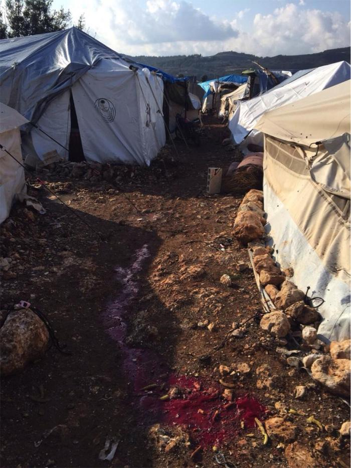 Blood on the ground in a tent camp for internally displaced near Younsyeh village in Idlib province after cluster munitions fell on the camp on November 9, 2015.