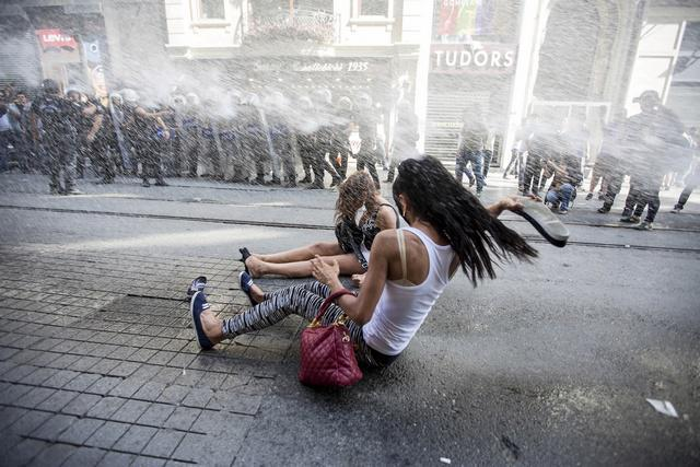 Riot police use a water cannon to disperse LGBT rights activist before a Gay Pride Parade in Istanbul, Turkey, on June 28, 2015.