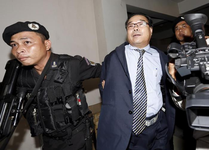 Senator Hong Sok Hour of the opposition Sam Rainsy Party (SRP) arrives at the Municipal Court of Phnom Penh in Cambodia on August 15, 2015.
