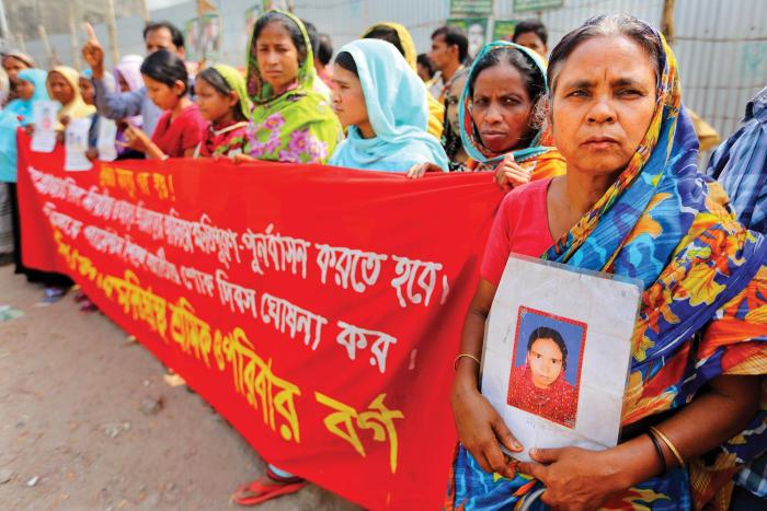 Victims of the 2013 Rana Plaza building collapse and their families demonstrating at the site of the disaster demanding full compensation.