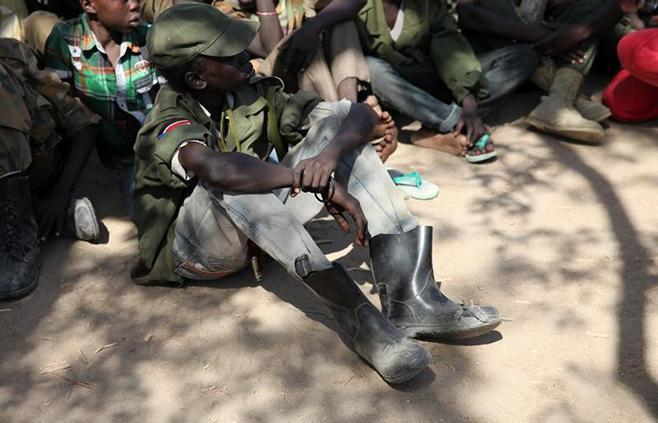 Rebel child soldiers gather in Gumuruk, South Sudan.