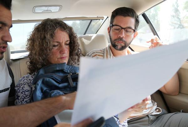 Letta Tayler (center) and Fred Abrahams (right), analyze ways to reach and interview displaced Yeizidis fleeing from the extremist group Islamic State (also known as ISIS) in Iraq on September 5, 2014.