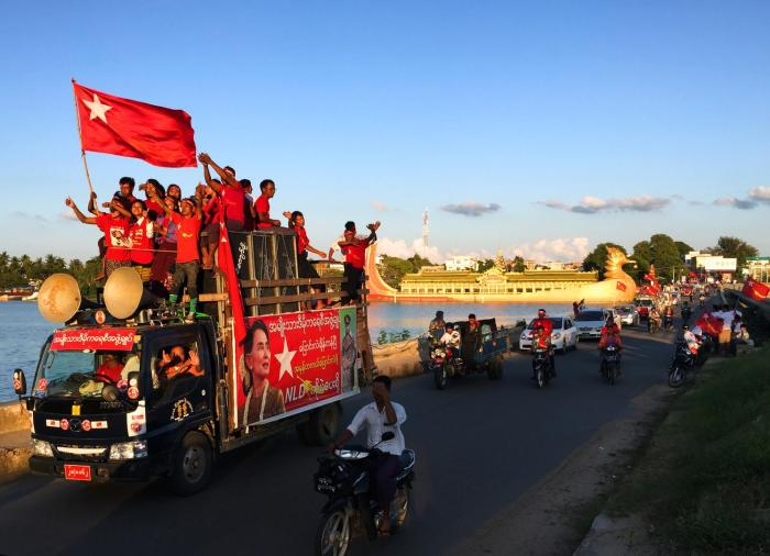 An NLD rally crosses the Meiktila Lake bridge on November 3, 2015.