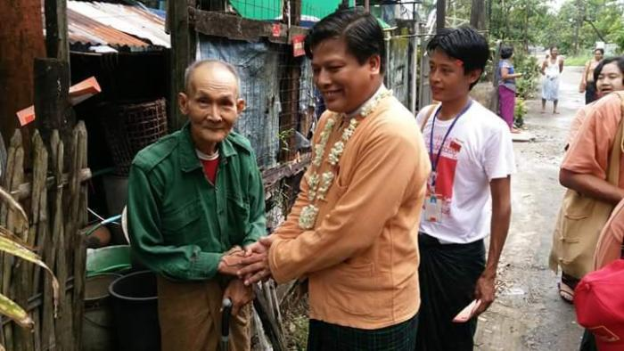 Naing Ngan Lin and a member of the National League for Democracy.