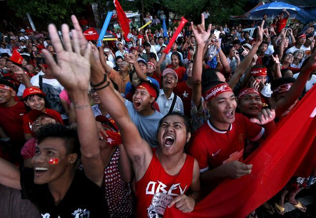 Supporters of Aung San Suu Kyi gather outside National League for Democracy headquarters (NLD) in Rangoon on November 9.
