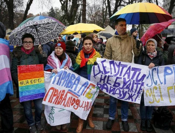 Gay rights activists attend a rally outside the parliament building in Kiev, Ukraine, November 10, 2015.