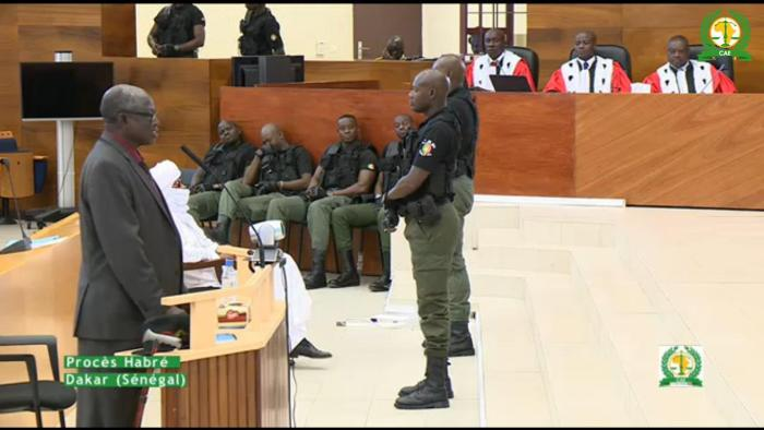 Souleymane Guengueng testifies at the trial of Hissène Habré as the former dictator listens. November 2015.