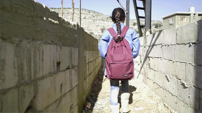 Bara'a, 10, originally from Ghouta, Syria, leaves for school from her informal refugee camp in Mount Lebanon.