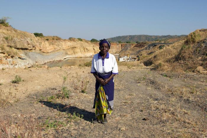 Nagomba E., 75, standing where her house used to be in Mwabulambo, Karonga district.