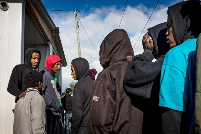 Unaccompanied children in the Calais migrant camp await interviews with the UK Home Office, October 22, 2016.