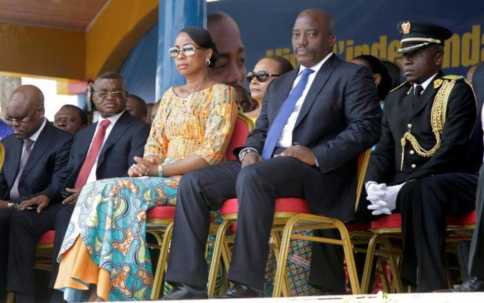 Kalev Mutond, Director of the National Intelligence Agency (ANR) in the Democratic Republic of Congo, sits to the right of First Lady Marie Olive Lembe and President Joseph Kabila during the country's independence anniversary celebration in Kindu, capital