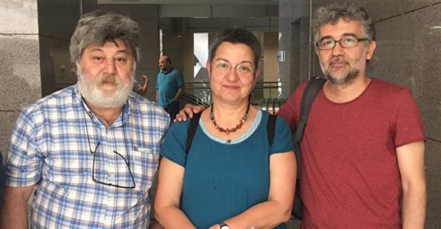 "Ahmet Nesin, Şebnem Korur Fincancı and Erol Önderoğlu at the court house in Istanbul hours before being jailed pending investigation into spurious allegations of ""making terrorist propaganda."""