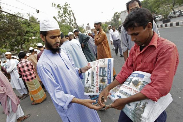 A man buys a local newspaper in Dhaka, Bangladesh on March 20, 2011.