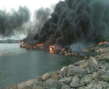 Fishing boats burn in al-Hayma Port in Hodaida governorate after the December 12 attack in which CBU-105 Sensor Fuzed Weapons were used.