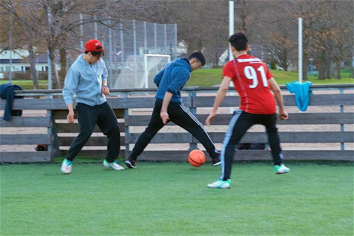 Afghan boys playing soccer at a group home in Gothenburg, Sweden.