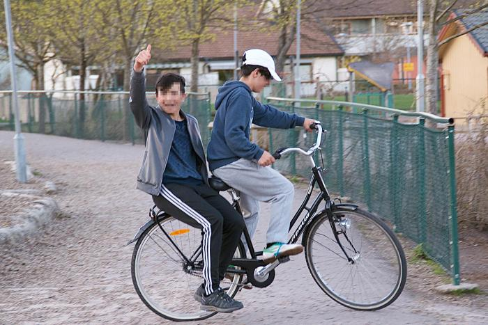 Afghan boys on a bike ride near their group home in Gothenburg, Sweden.