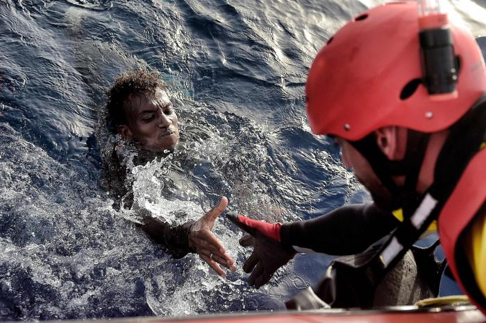 A migrant is rescued from the mediteranean sea by a member of Proactiva Open Arms NGO some 20 nautical miles north of Libya on October 3, 2016.