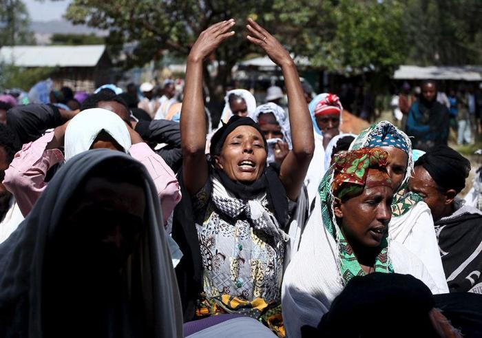 Women mourn during the funeral ceremony of a primary school teacher who family members said was shot dead by military forces during protests in Oromia, Ethiopia in December 2015. December 17, 2015.